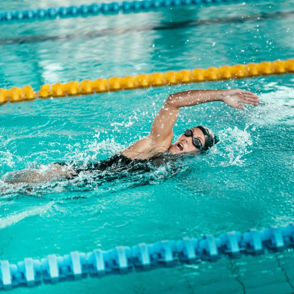 Exercise is a critical component in reducing body mass, and swimming burns about 266 calories in 30 minutes.