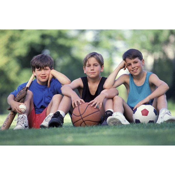 children with different sports equipment