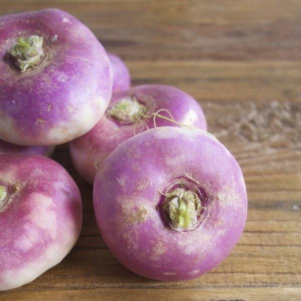 Purple turnips on a wood table.