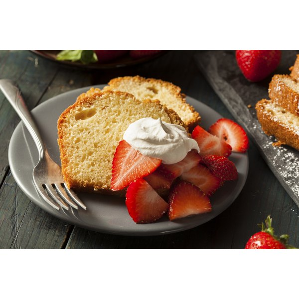 Serve strawberry pound cake with fresh strawberries and cream.