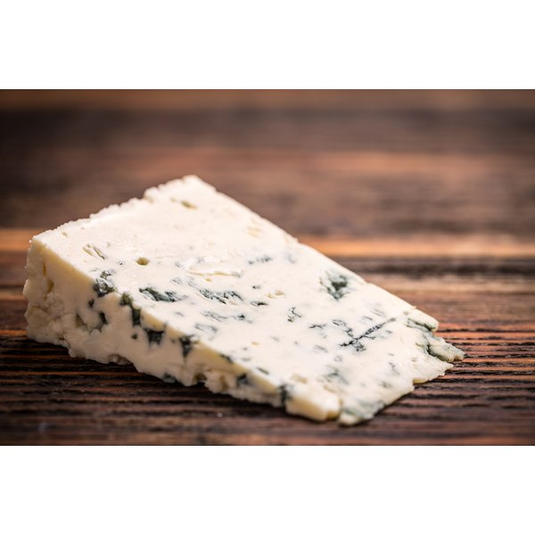 A large slice of blue cheese.