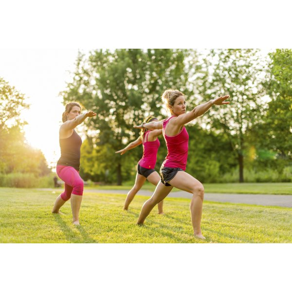 women exercising on grass