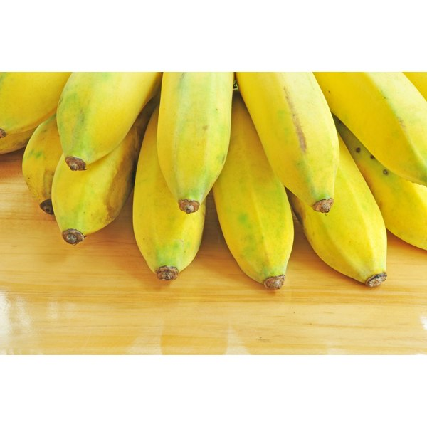 Bananas on a wood surface.