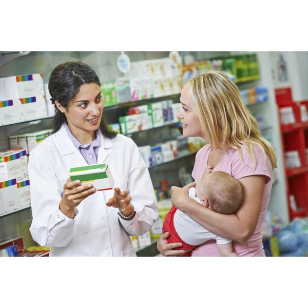 A woman is talking to a pharmacist.