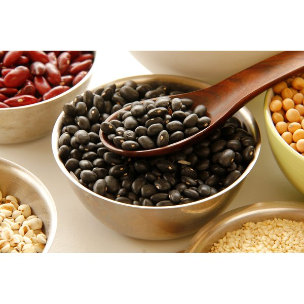 Bowls of beans and legumes on a counter.