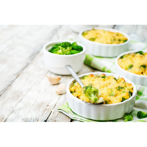 Homemade casseroles in white dishes.