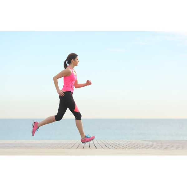 A woman is running on a pier.