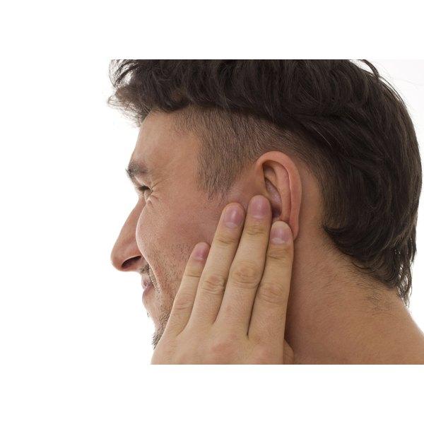 man covering ear hair
