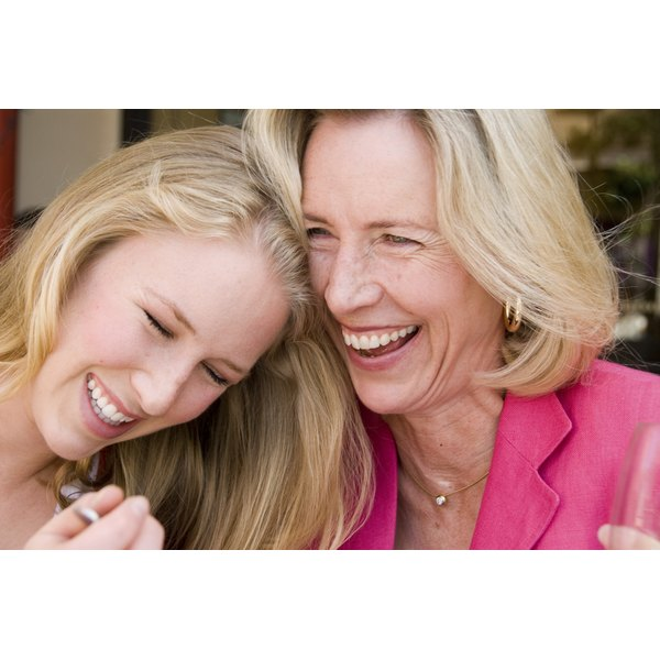 Close up of a mature woman laughing with her daughter