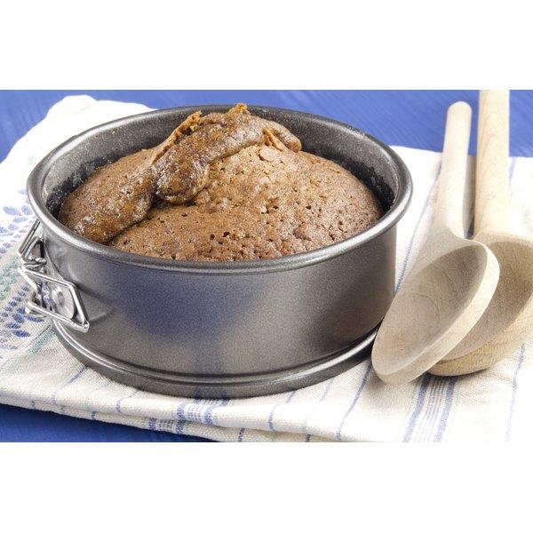 Dark baking pan with cake inside