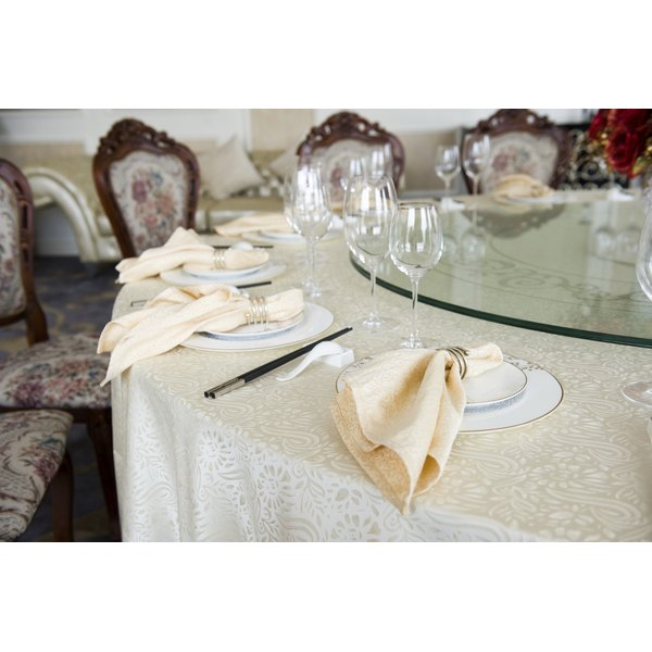 A table set for a wedding reception inside a home.