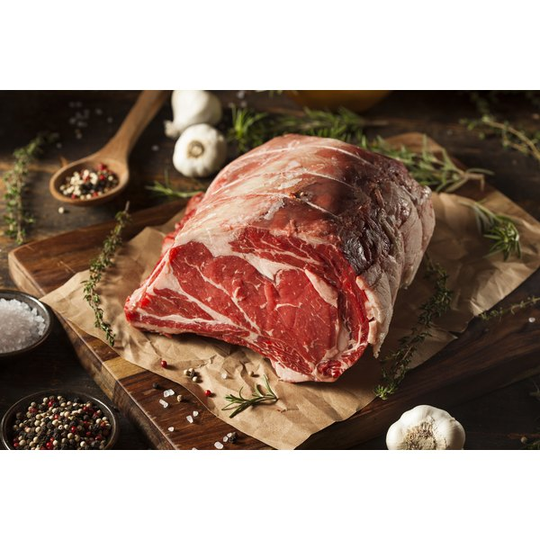 What Is the Difference Between a Prime Rib Roast & a Rib-Eye Roast?