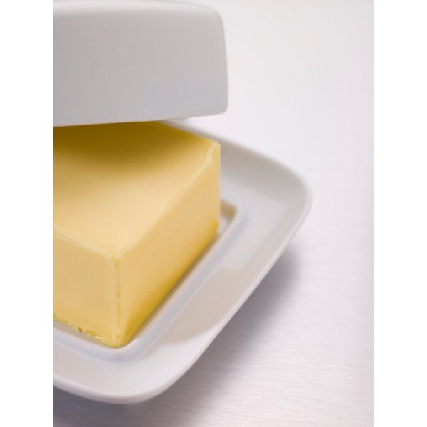 Butter is a good choice for greasing your cake pans.