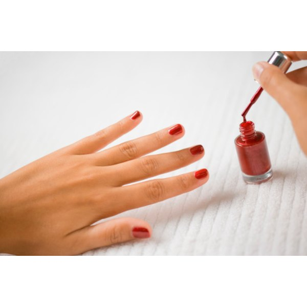 Apply a thin layer of polish to each clean fingernail in three even strokes.