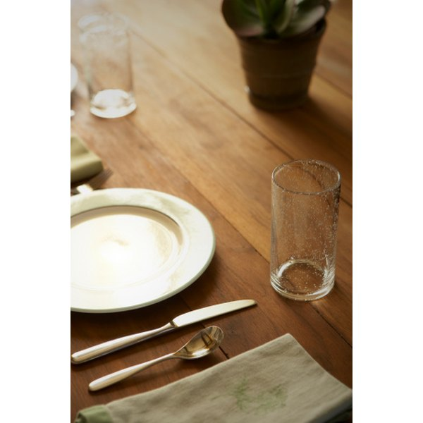 Informal table settings have fewer utensils and plates than formal settings.