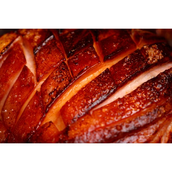 Cook a fresh ham on the grill.