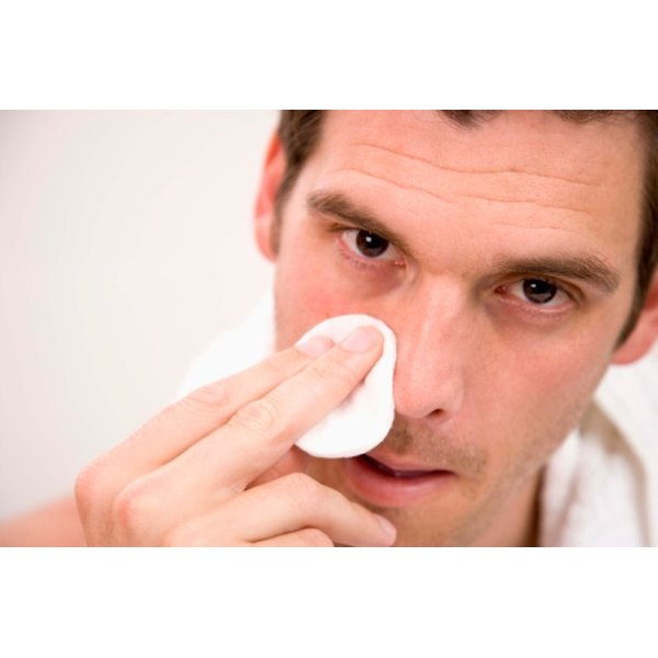 Apply gentle pressure to stop your nose from bleeding.