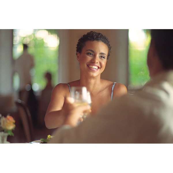 Plan a romantic dinner, complete with a champagne toast, for you and your new spouse after your marriage is finalized.