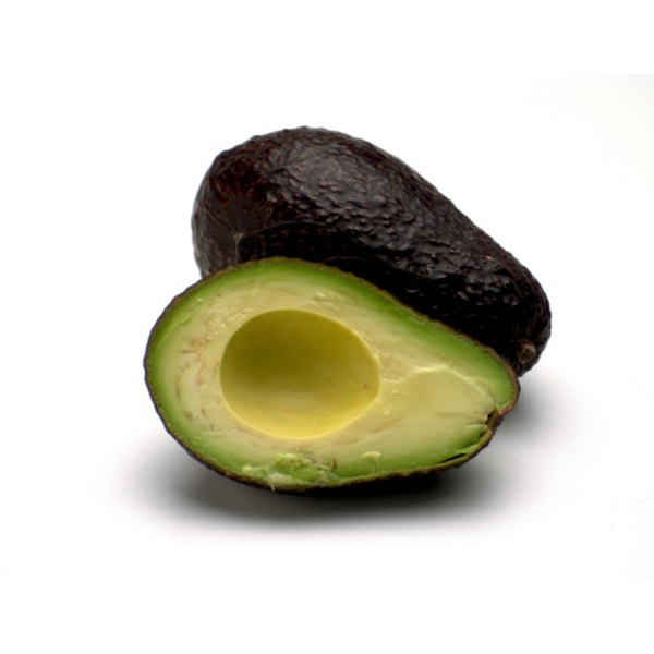 This avocado is ready to peel and cube.