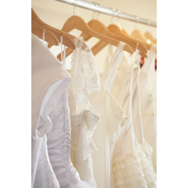 Brides often try on many gowns before selecting the cut that works best for their figure.