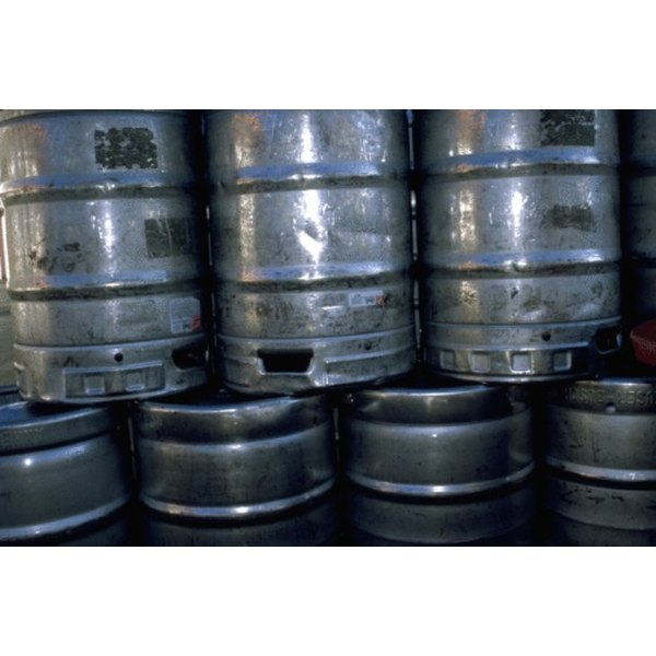 Cleaning a beer keg with caustic soda removes built up particles.