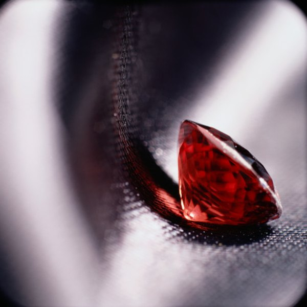 Polish precious garnet stones to preserve their shine.