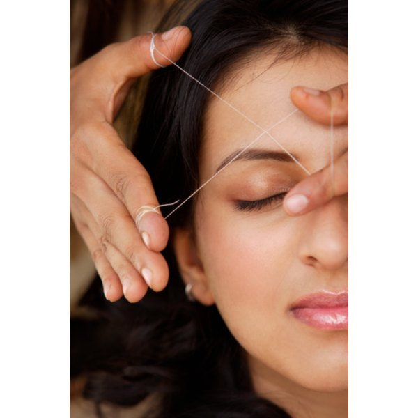 Eyebrow threading gets rid of unwanted eyebrow hair.