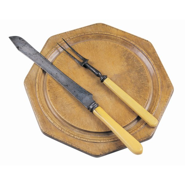 A cutting board, carving fork and sharp carving knife are required for slicing beef brisket.