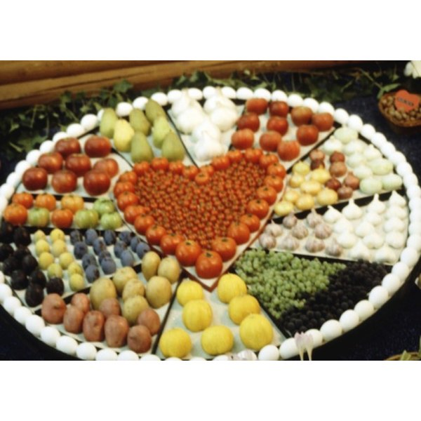 Creative buffet food displays enhance your wedding's theme and mood.