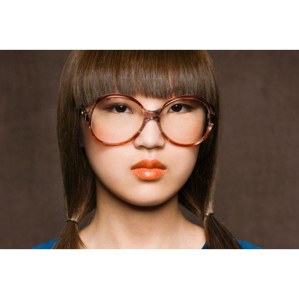 Wearing bangs will hide a large forehead pore.