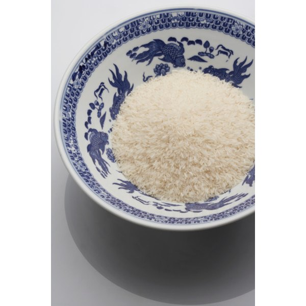 Make rice less starchy by parboiling it.