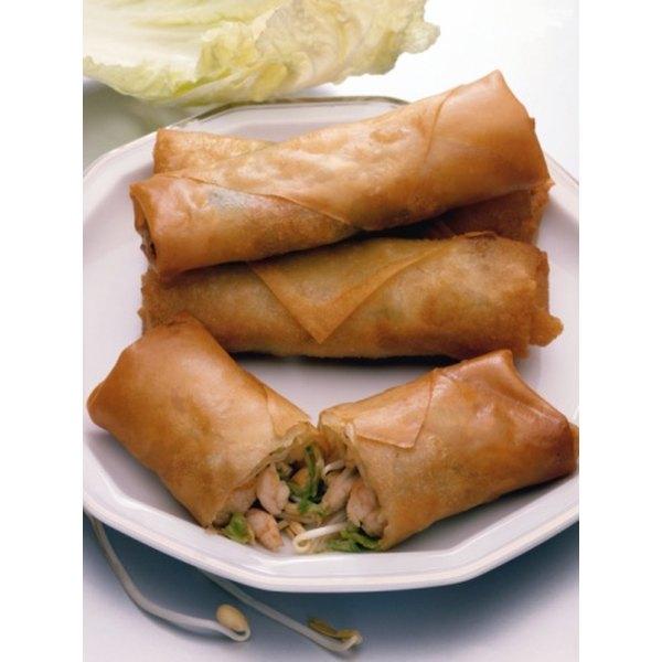 Deep frying egg rolls gives them a crunchy golden shell.