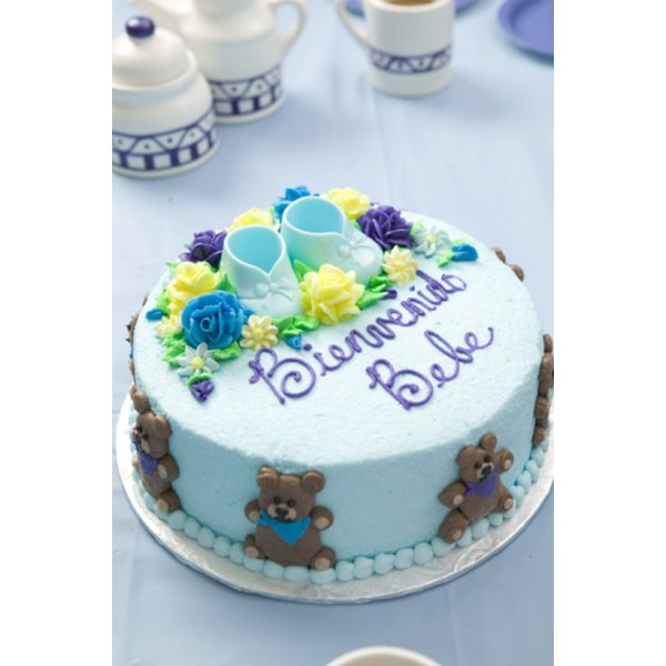 Use buttercream frosting to create delicate booties and rattles.
