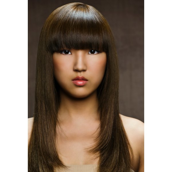 Blunt, straight bangs create a modern, bold style.
