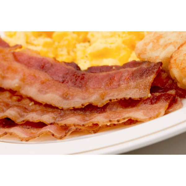 Cooks can fry or bake bacon strips after curing.