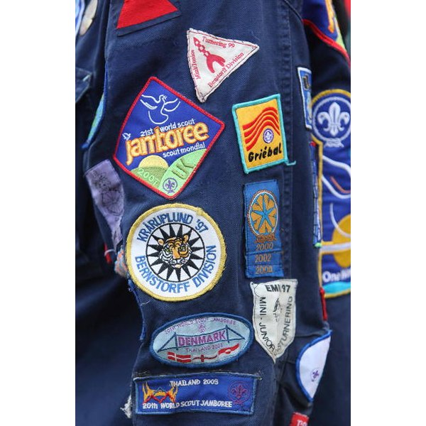 Use adhesive to attach Boy Scout badges.