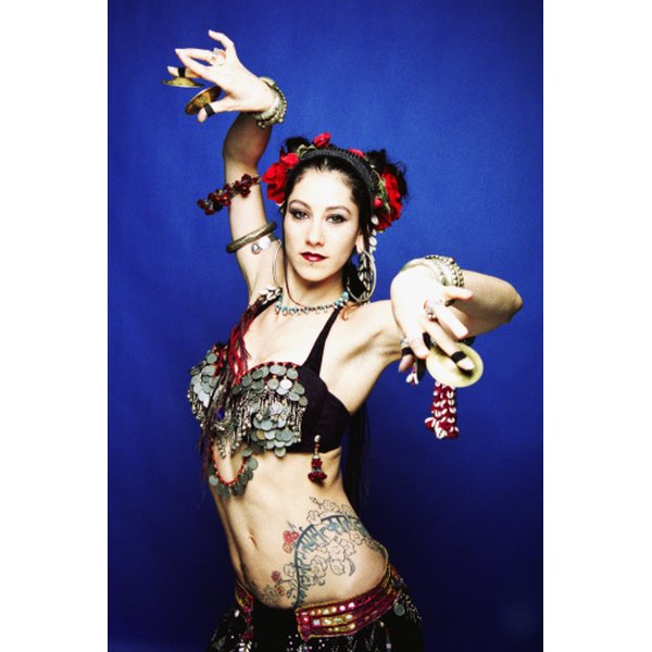 Tribal style belly dancers adorn their costumes with vintage coins and fabrics.