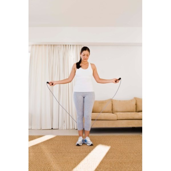 Woman jumping rope in her living room.