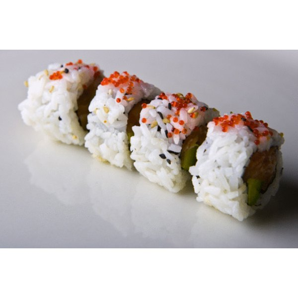Make sushi rolls using prepared rice.