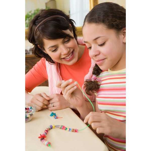 Five-year-old girls can use a variety of beads to make their own jewelry.