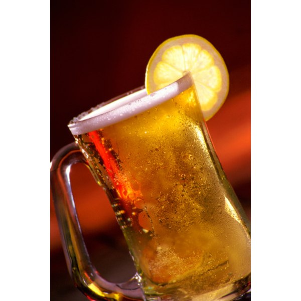 Squeeze fresh lemon juice into beer to reduce bitterness.