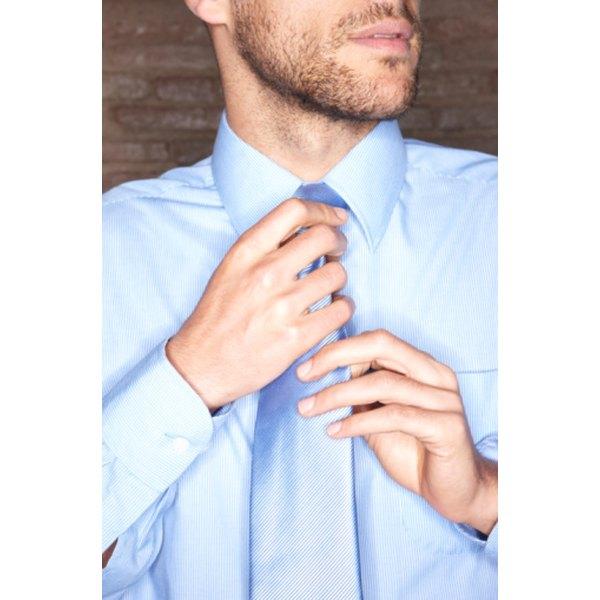 Loosen a necktie to adjust it or remove it.