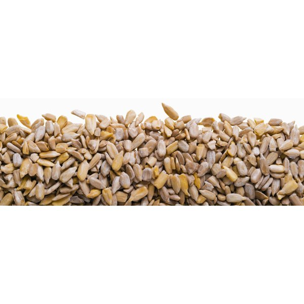 Grind raw sunflower seeds to add heart-healthy omega-3 fatty acids to your morning oatmeal.