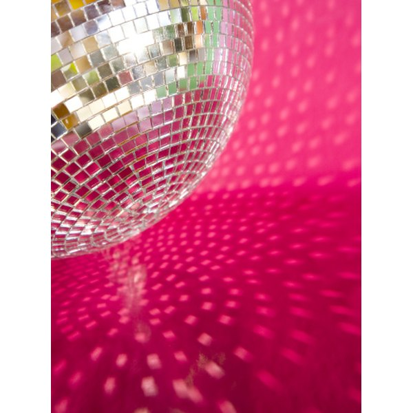 Use funky, mirrored disco balls to point your guests toward the dance floor.