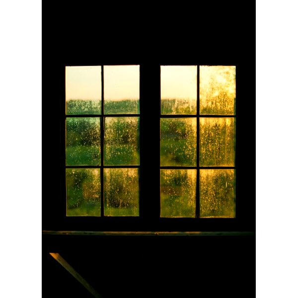 Cover an exterior window to protect it from inclement weather or vandalism.