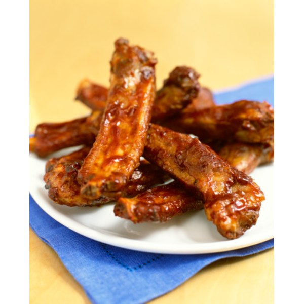 Bake spare ribs before grilling to tenderize them.