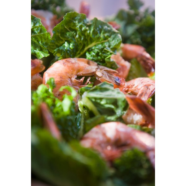 The garlicky sizzling shrimp in butter and wine makes a dressing for green salad.