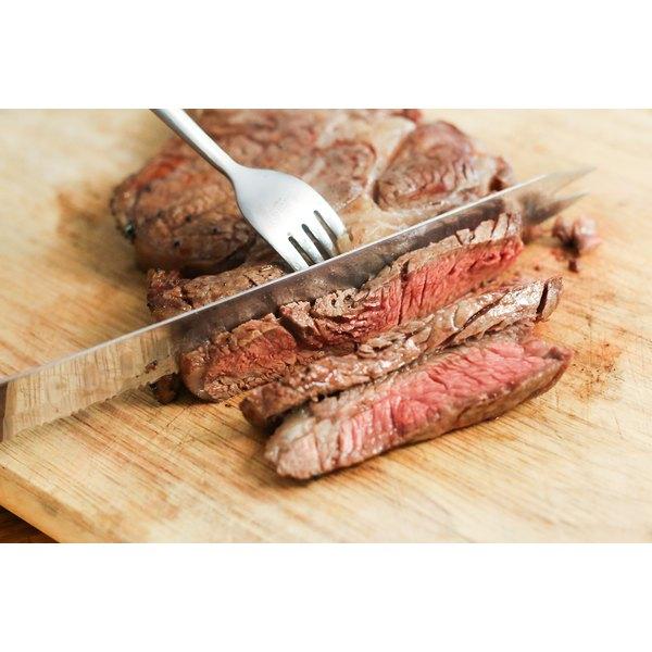 Slicing a rib steak.