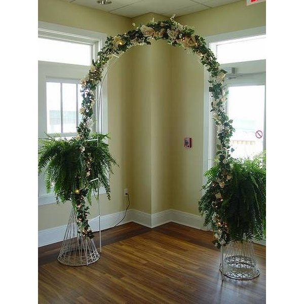 Floral arch with ferns and lights