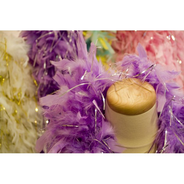 Attach feather boas to a child's dance costume with basic sewing supplies.